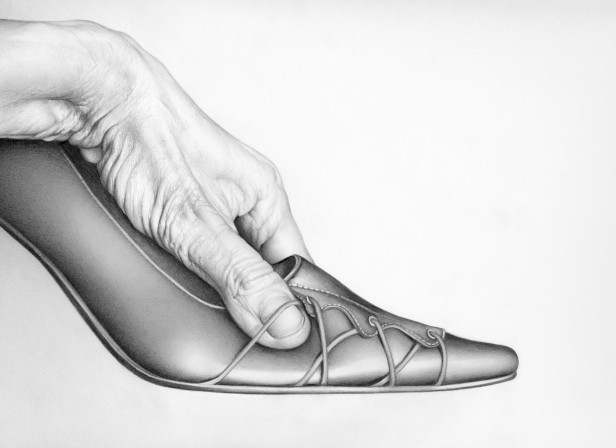 Male Hand Grasping Womans Stiletto Shoe